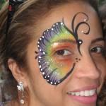 rainbow butterfly face paint www.glittermenyc.com